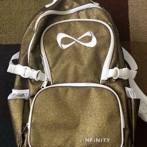 Gold and White Nfinity Backpack .